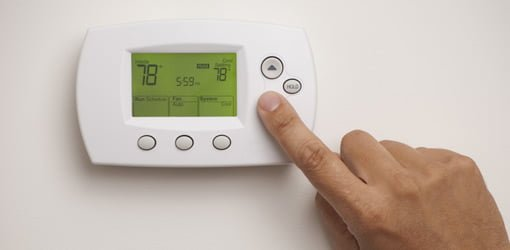 Setting the digital thermostat on a central air conditioner
