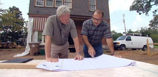 Danny Lipford going over plans on job site with architect.