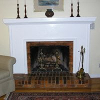 Wood burning fireplace converted to gas logs.