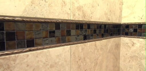 Mosaic tile band in shower surround.