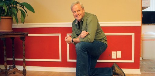 Danny Lipford with wainscotting on wall.