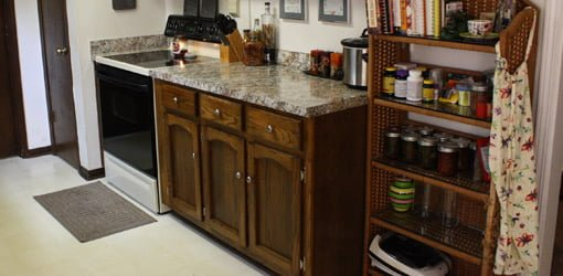 Kitchen remodeled on a budget with new countertop and refinished cabinets.