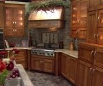 Kitchen cabinets with built-in range and hood.