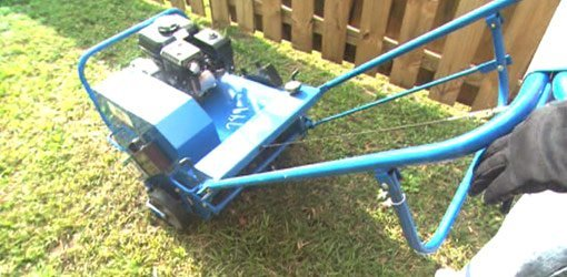 Gas powered lawn aerator.
