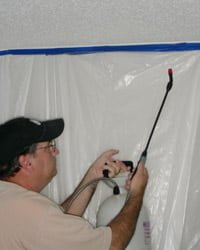 Spraying textured ceiling with solution using a sprayer