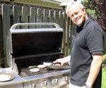Danny Lipford grilling on a gas grill.