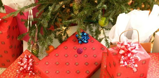 Tool gifts wrapped under Christmas tree.