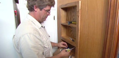Man with built-in wall cabinet.