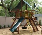 Wooden playset in backyard.