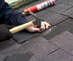 replacing damaged asphalet roof shingles