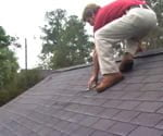 man on roof wearing cougar paws safety boots