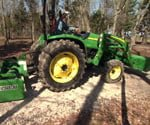 compact tractor in yard