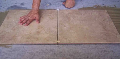Tile being laid on a floor