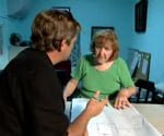 allen and a woman studying building codes