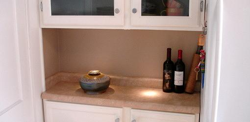 Under-cabinet LED light shining on kitchen counter