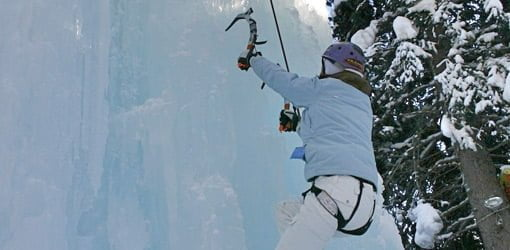 Climbing up a vertical wall of ice