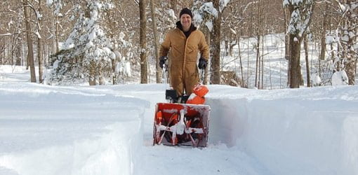 Joe Truini and his Ariens snowblower clearing a path to his door