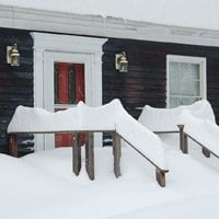 Front entrance to house covered with snow