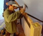 Assembling a staircase railing on the landing