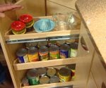 Pullout tray rack on corner kitchen cabinet