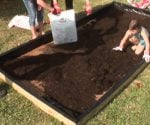 Filling raised planting bed with soil