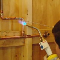 Soldering copper pipes with torch