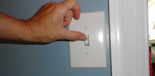 Turning new wall switch on and off to test it