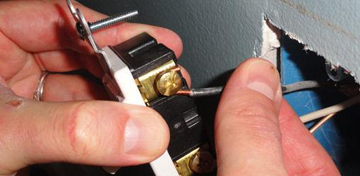 Attaching wires to light switch.