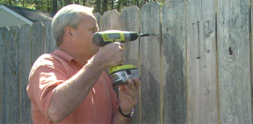 Repairing a Wooden Fence