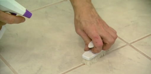 Cleaning grout lines with a scrub brush