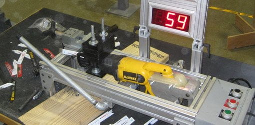 Jig to test the cutting speed of DeWalt reciprocating saw blades.