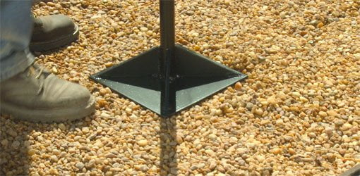 Using a tamp to compact gravel base