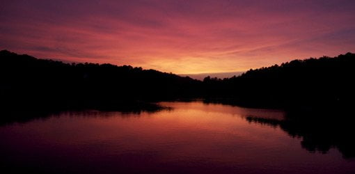 Sunset over lake with red sky