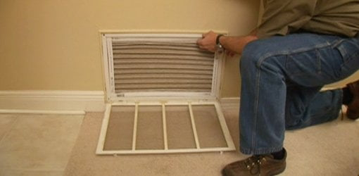 Changing the air filter on an air conditioner return.