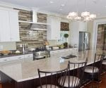 Kitchen with lighting over bar island