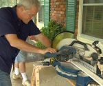 Danny Lipford cutting crown molding on power miter saw