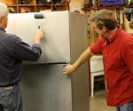 Danny Lipford and Allen Lyle refinishing a refrigerator with Liquid Stainless Steel