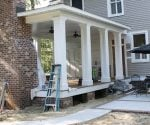 Finished back porch addition with fireplace