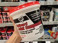 Container of joint compound