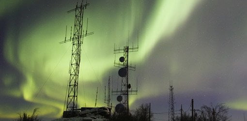Northern lights over communication towers