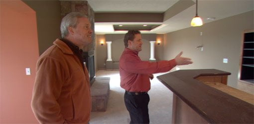 Danny Lipford with Matt Cook in remodeled basement