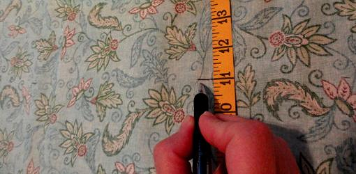 Measuring fabric with tape measure