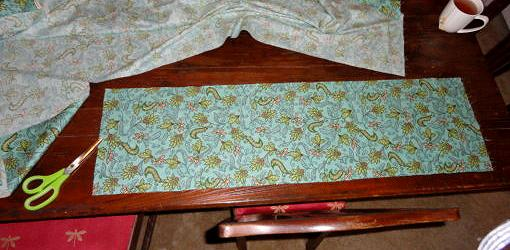 Cut fabric on table