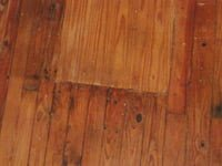 Floor with patches before painting.