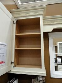 Face frame cabinet with overlay door.