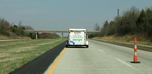 Moving trailer on highway.