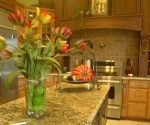 Kitchen with wood range hood in home on tour