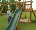 Danny Lipford with wooden play set in backyard