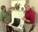 Allen Lyle and Danny Lipford with door reused as desk.
