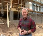 Danny Lipford in front of sunroom addition under construction.
